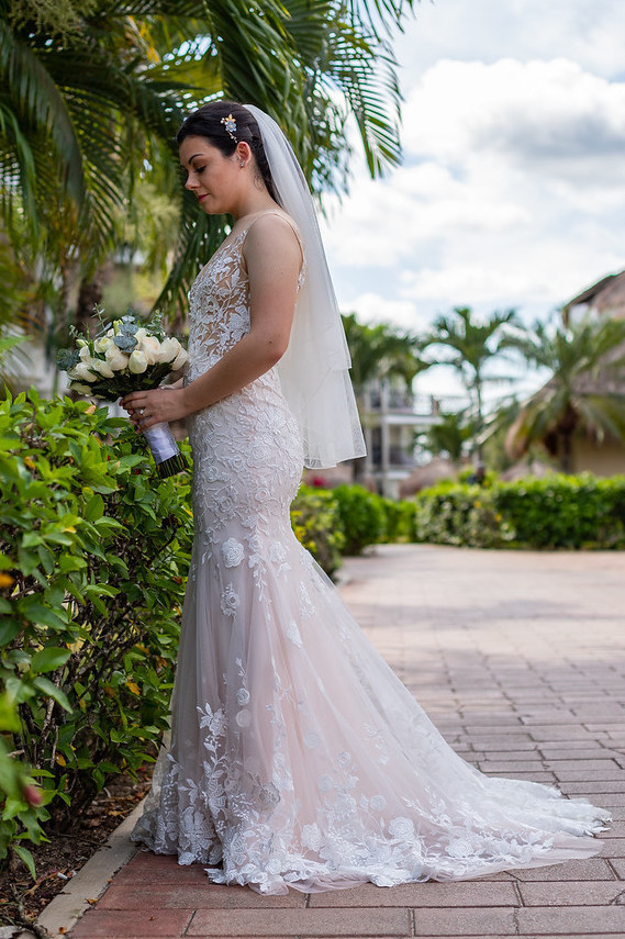 Brides can customize fit and flare or mermaid wedding dress with delicate floral lace at Anomalie Online Wedding Dresses.