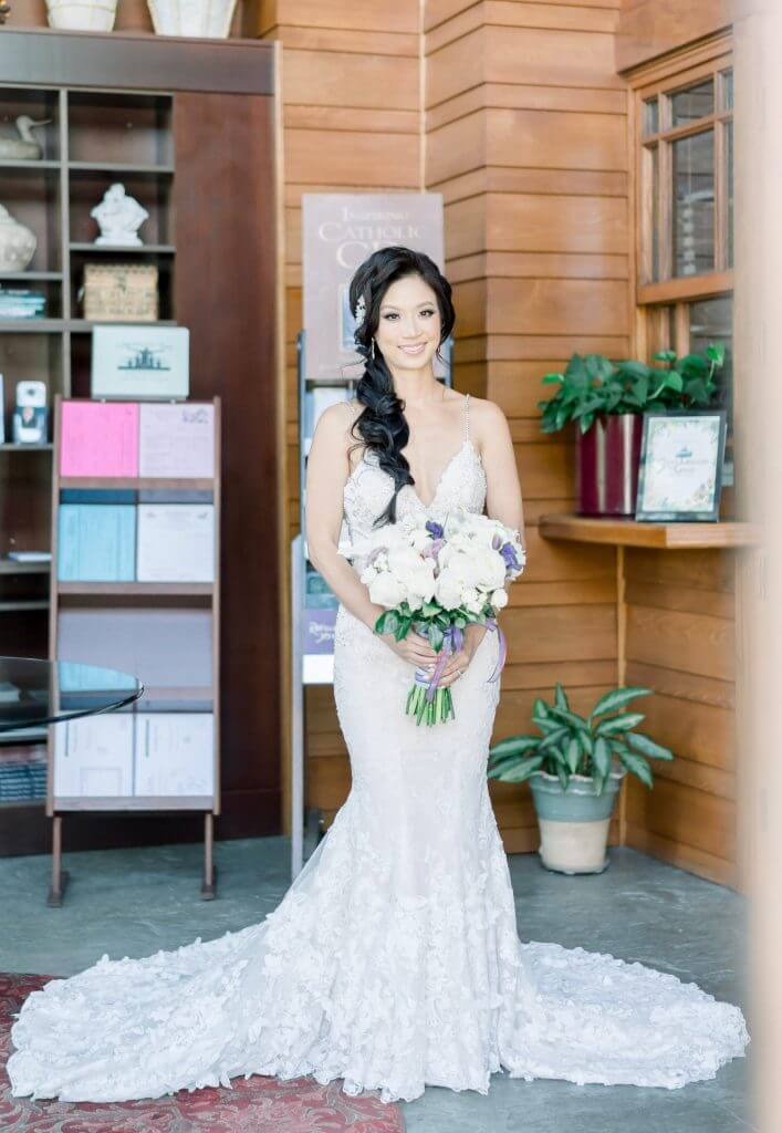 Brides can customize fit and flare or mermaid wedding dress at Anomalie Online Wedding Dresses. Add 3d florals and glittery beading.