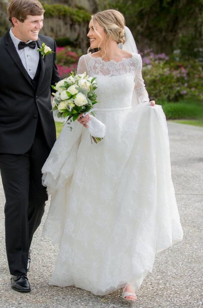 Anomalie creates online custom wedding dresses, including gowns with a-line silhouette, delicate sheet lace, quarter length sleeves, and scalloped hem.