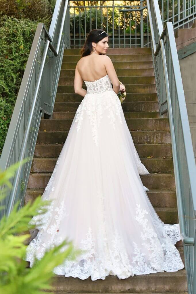 Anomalie creates online custom wedding dresses, including gowns with a-line silhouette, floral lace, unlined bodice, and long train.