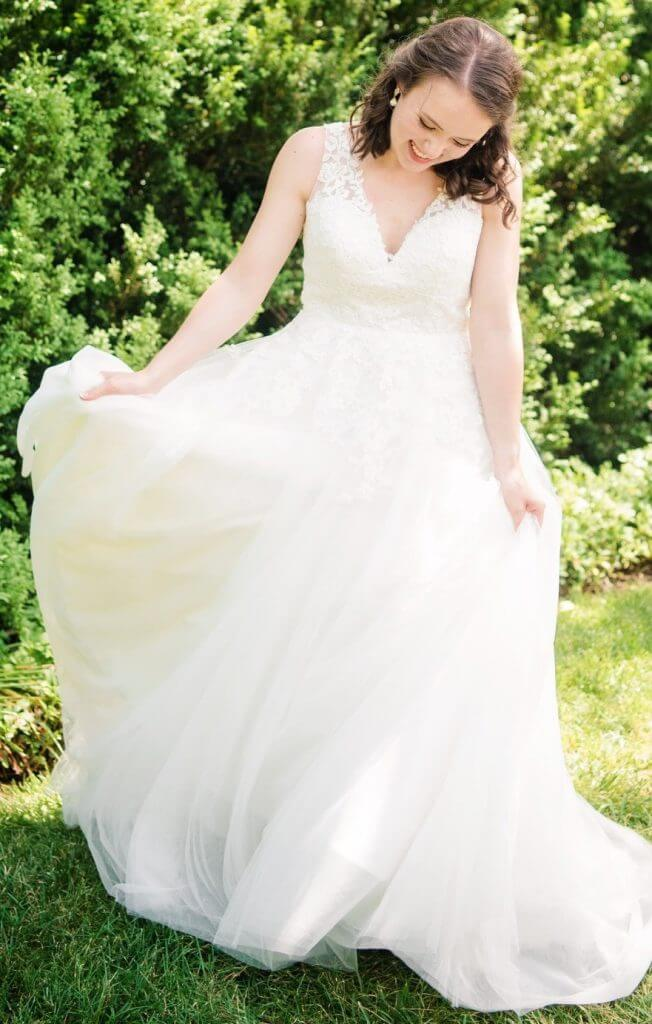 Anomalie creates online custom wedding dresses, including gowns with a-line silhouette, floral lace applique, and v-neck.