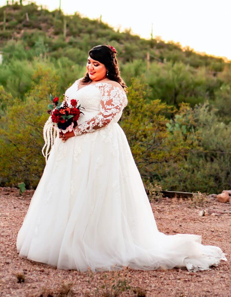 Anomalie creates online custom wedding dresses, including gowns with a-line silhouette, lace, and longsleeves.