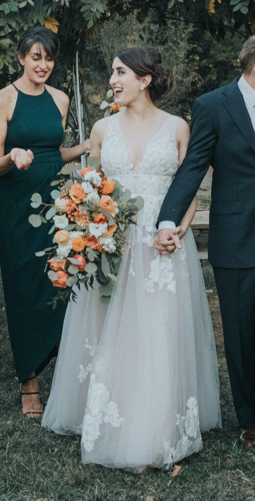 Anomalie creates online custom wedding dresses, including gowns with a-line silhouette, lace, nude lining, v-neck, tulle.