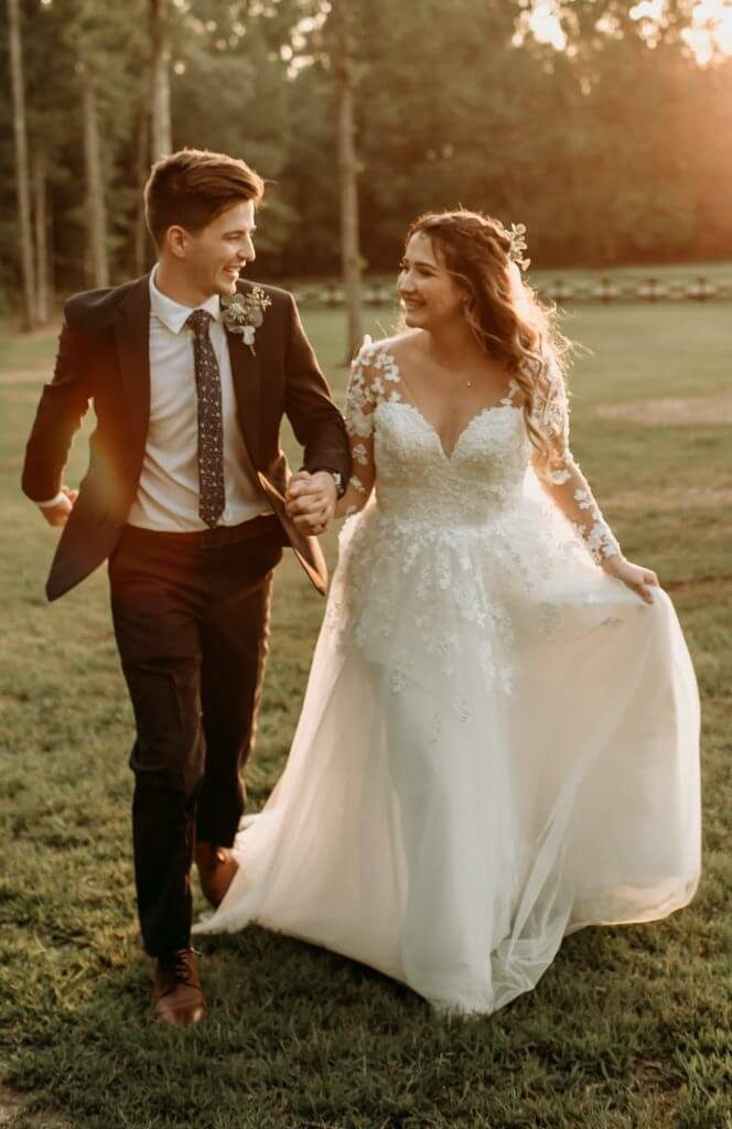 Anomalie creates online custom wedding dresses, including gowns with a-line silhouette, lace, long sleeves, v-neck, and natural lace edge.