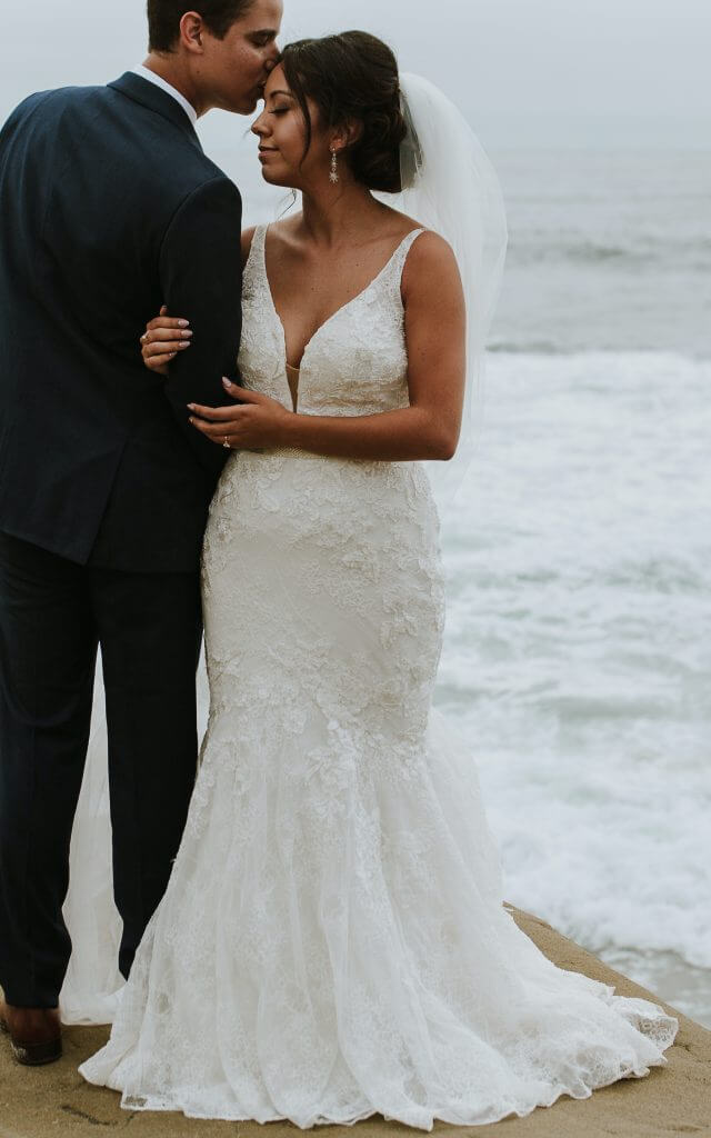 Brides can customize fit and flare or mermaid wedding dress with a fuller flare  at Anomalie Online Wedding Dresses.