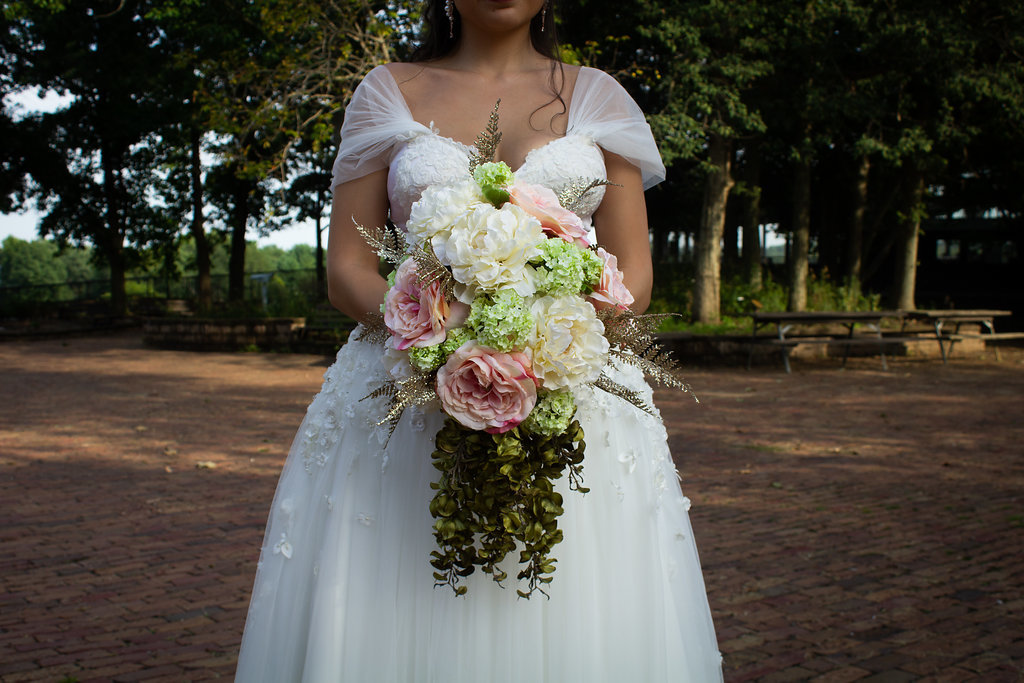 Ruched off-the-shoulder sleeves on custom Anomalie wedding dress