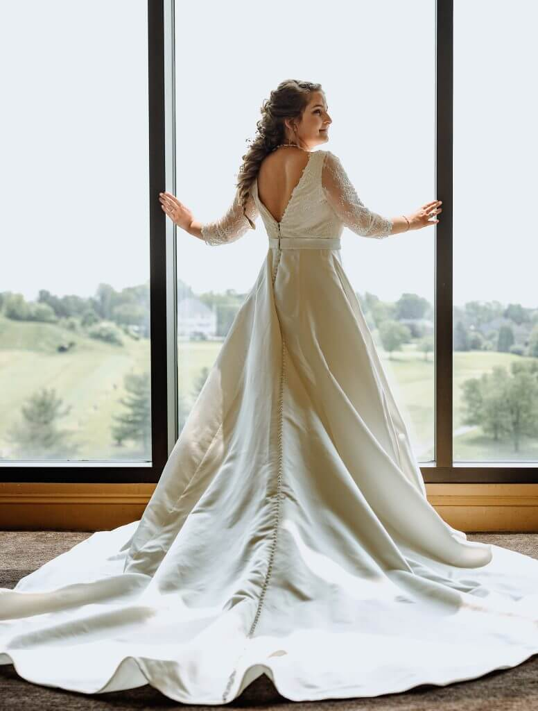 Anomalie creates online custom wedding dresses, including gowns with structured sating a-line silhouettes.