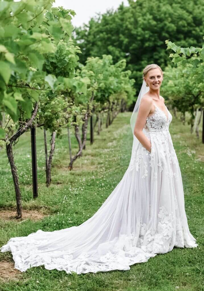 Anomalie creates online custom wedding dresses, including gowns with a-line silhouette, lace, and pockets.