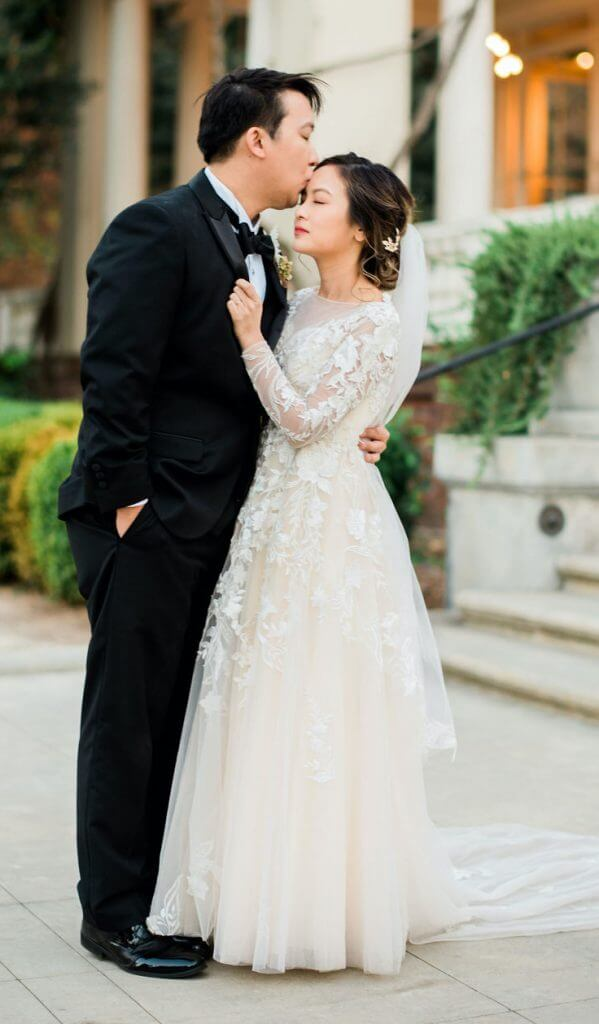 Anomalie creates online custom wedding dresses, including gowns with a-line silhouette, lace, long sleeves, floor length train.