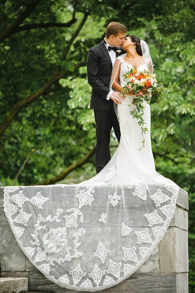 Brides can customize fit and flare or mermaid wedding dress at Anomalie Online Wedding Dresses. Add a long unlined train.