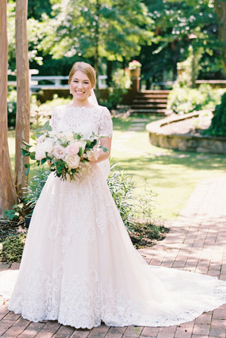 Anomalie creates online custom wedding dresses, including boho gowns with an unlined lace bodice and sweetheart neckline.