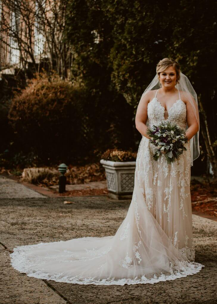 Anomalie creates online custom wedding dresses, including gowns with strappy top and full a-line skirt silhouette.