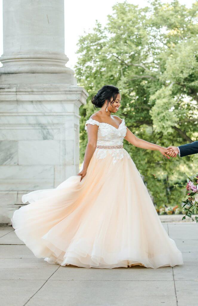 Anomalie creates online custom wedding dresses, including gowns with blush hues and a-line silhouette.