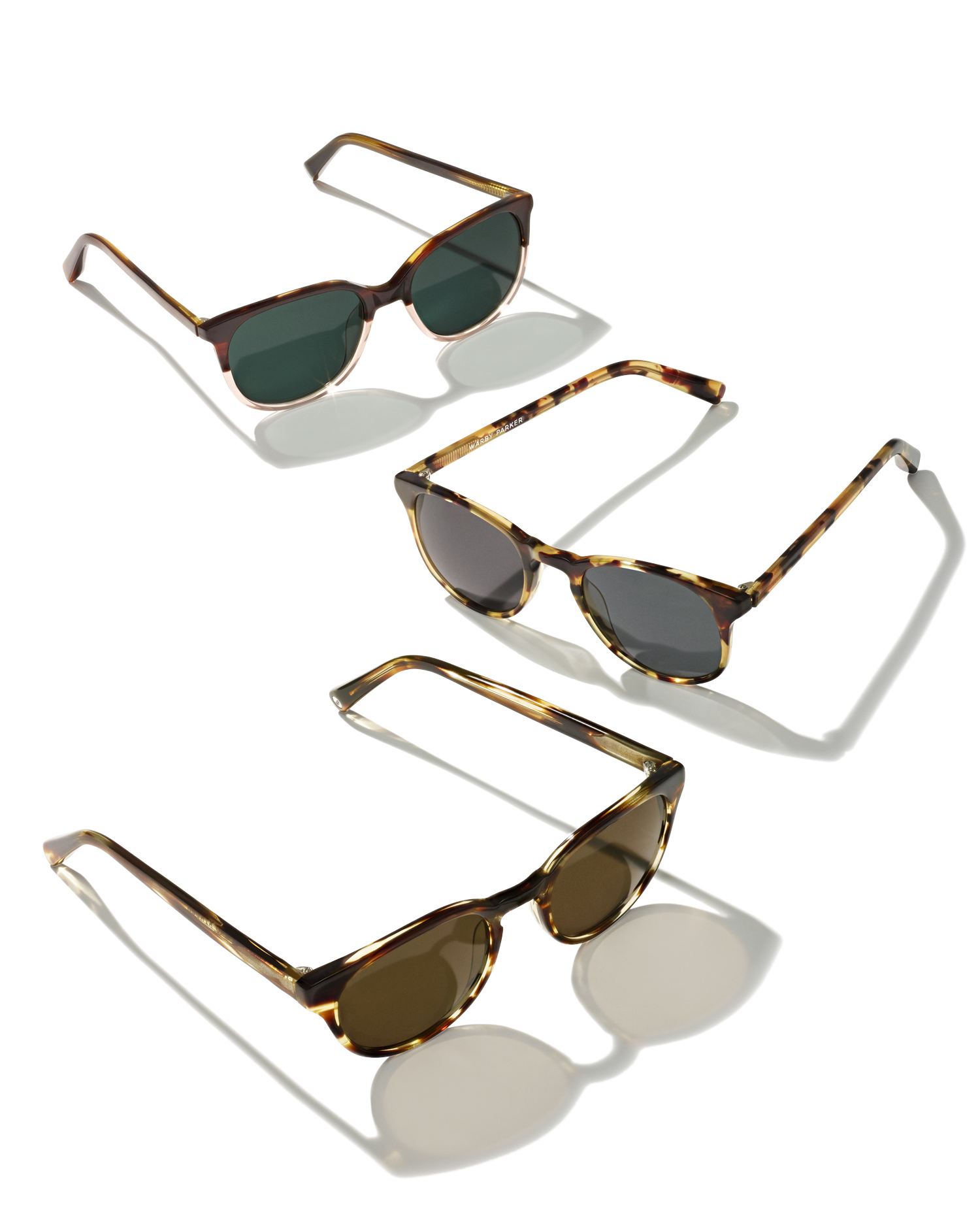 Sunglasses in different shapes and colors, by Warby Parker.