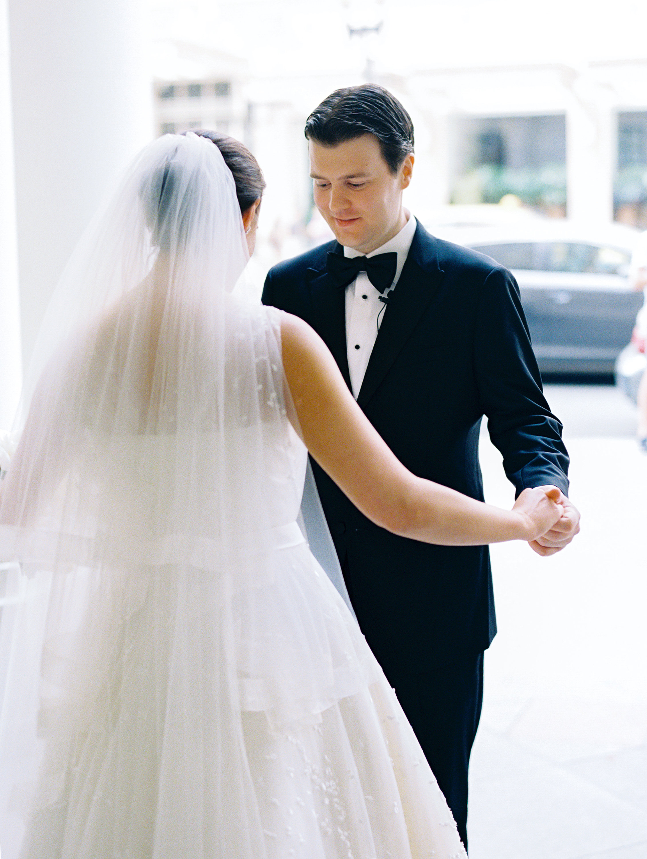 The groom enjoys the sight of his bride