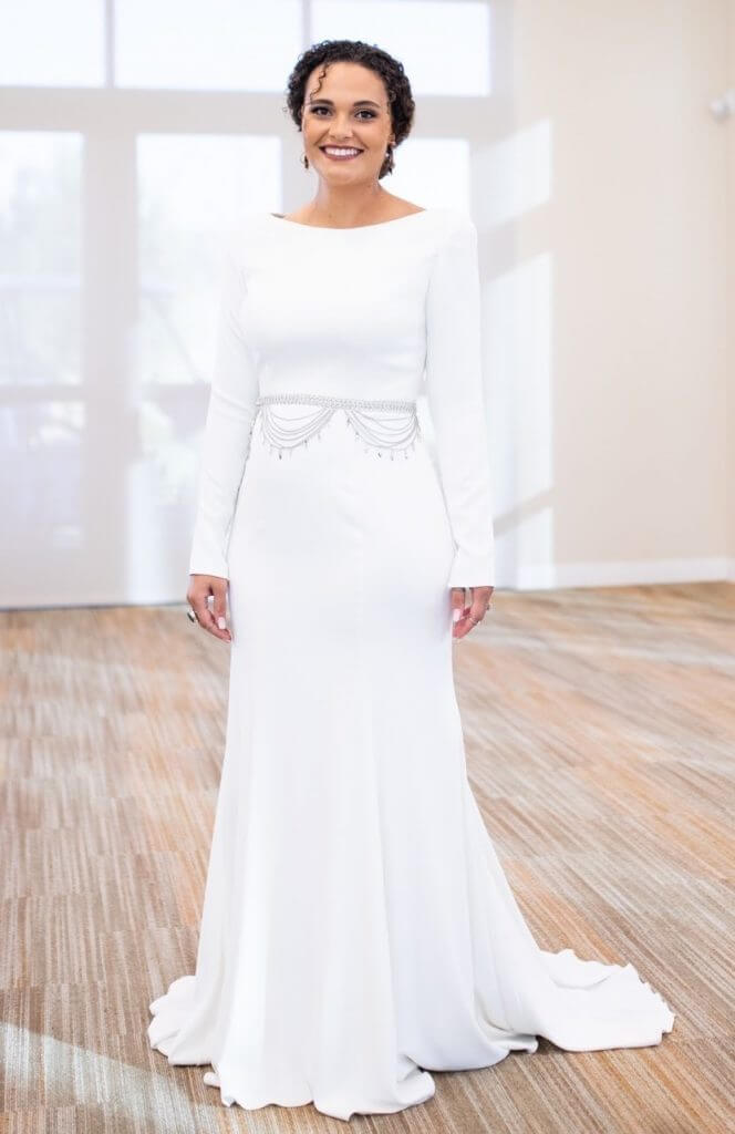 Anomalie creates online custom wedding dresses, including boho gowns with a poly crepe skirt anf long sleeves.
