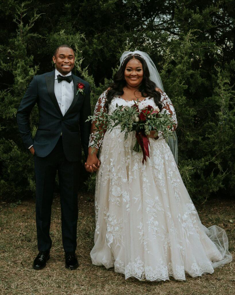 Anomalie creates online custom wedding dresses, including gowns with a-line silhouette, lace, cascading floral applique.