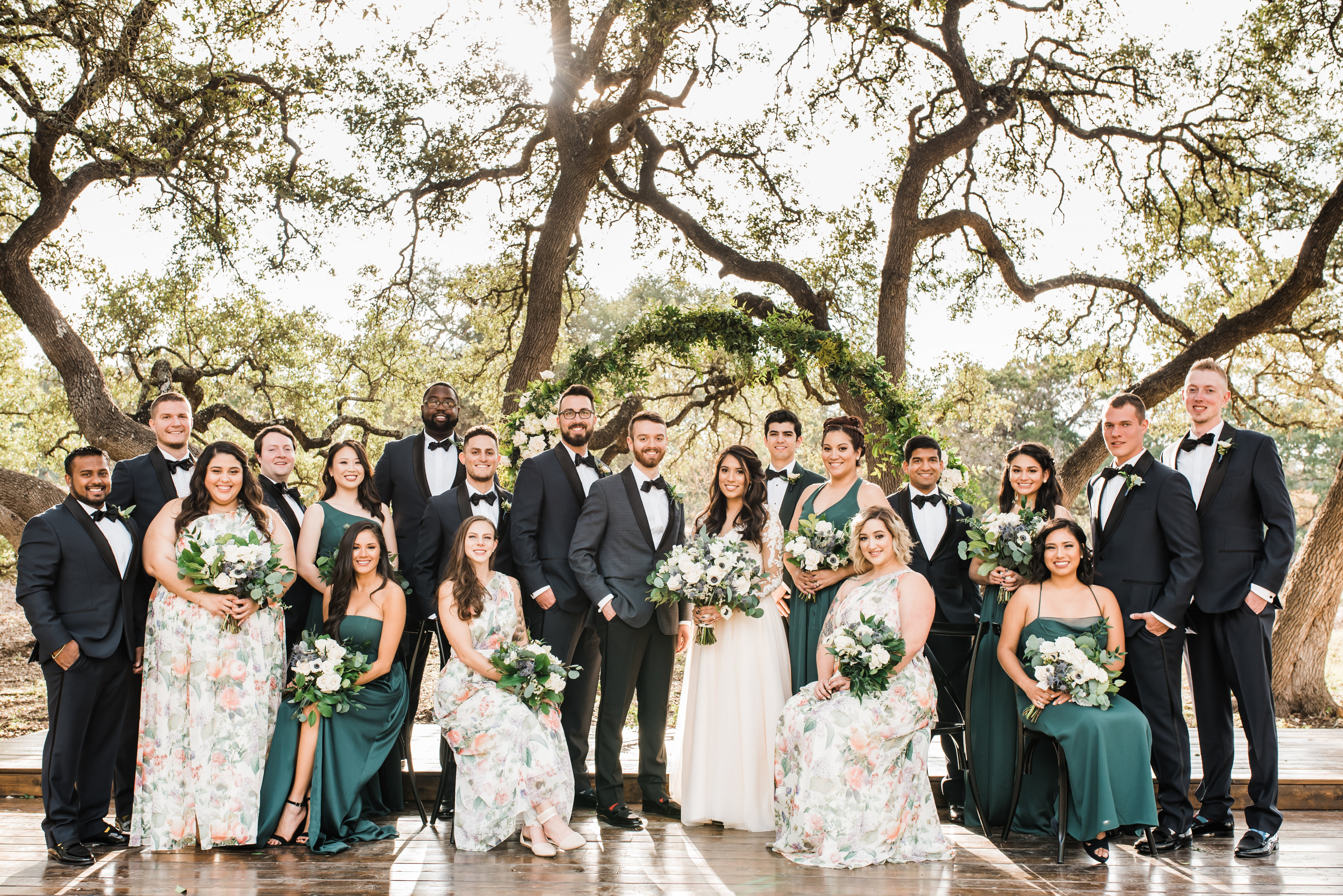bridal party with green and floral bridesmaids dresses, blush wedding gown