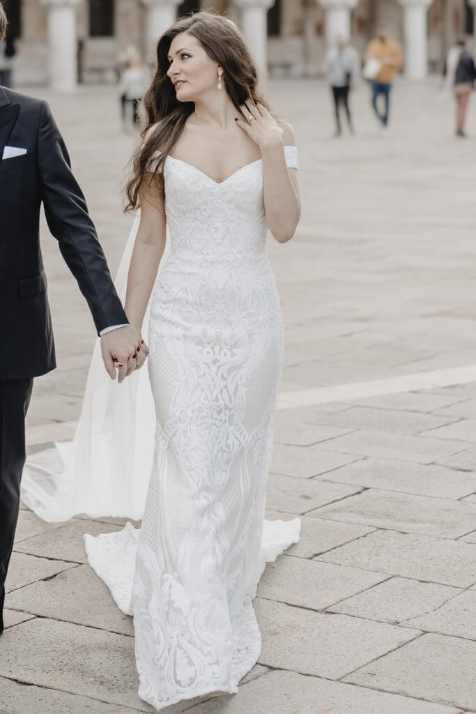 Brides can customize fit and flare or mermaid wedding dress with a v-neckline at Anomalie Online Wedding Dresses.
