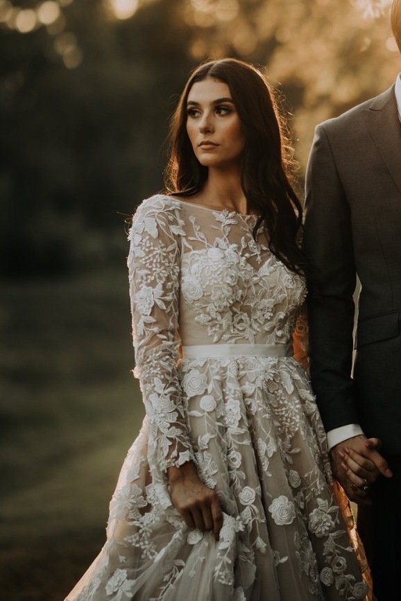 Anomalie specialized in making online wedding dresses for petite brides, including dresses with long sleeves, nude lining, and all over floral lace.