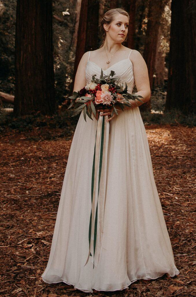 Anomalie creates online custom wedding dresses, including boho gowns with a silk chiffon circle skirt and pleating.