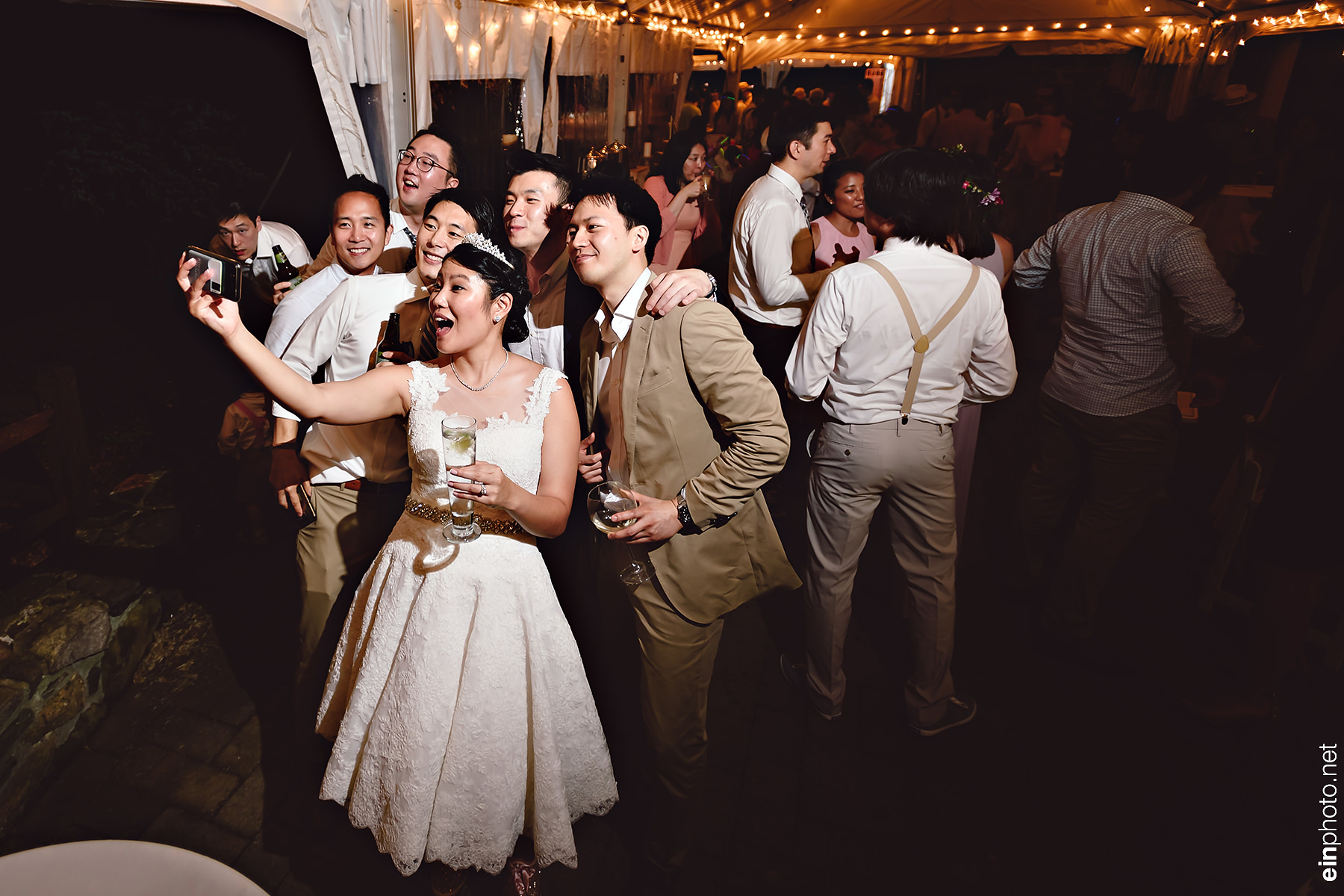 Bride taking a selfie with the groomsmen.