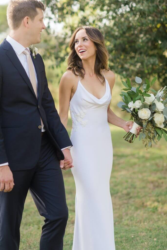 Anomalie creates online custom wedding dresses, including boho gowns with a cowl neck and simple crepe fit and flare.