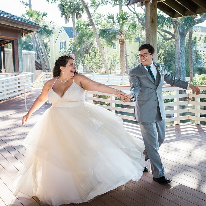 Anomalie bride wearing a tiered, champagne, sparkle dress in plus size.