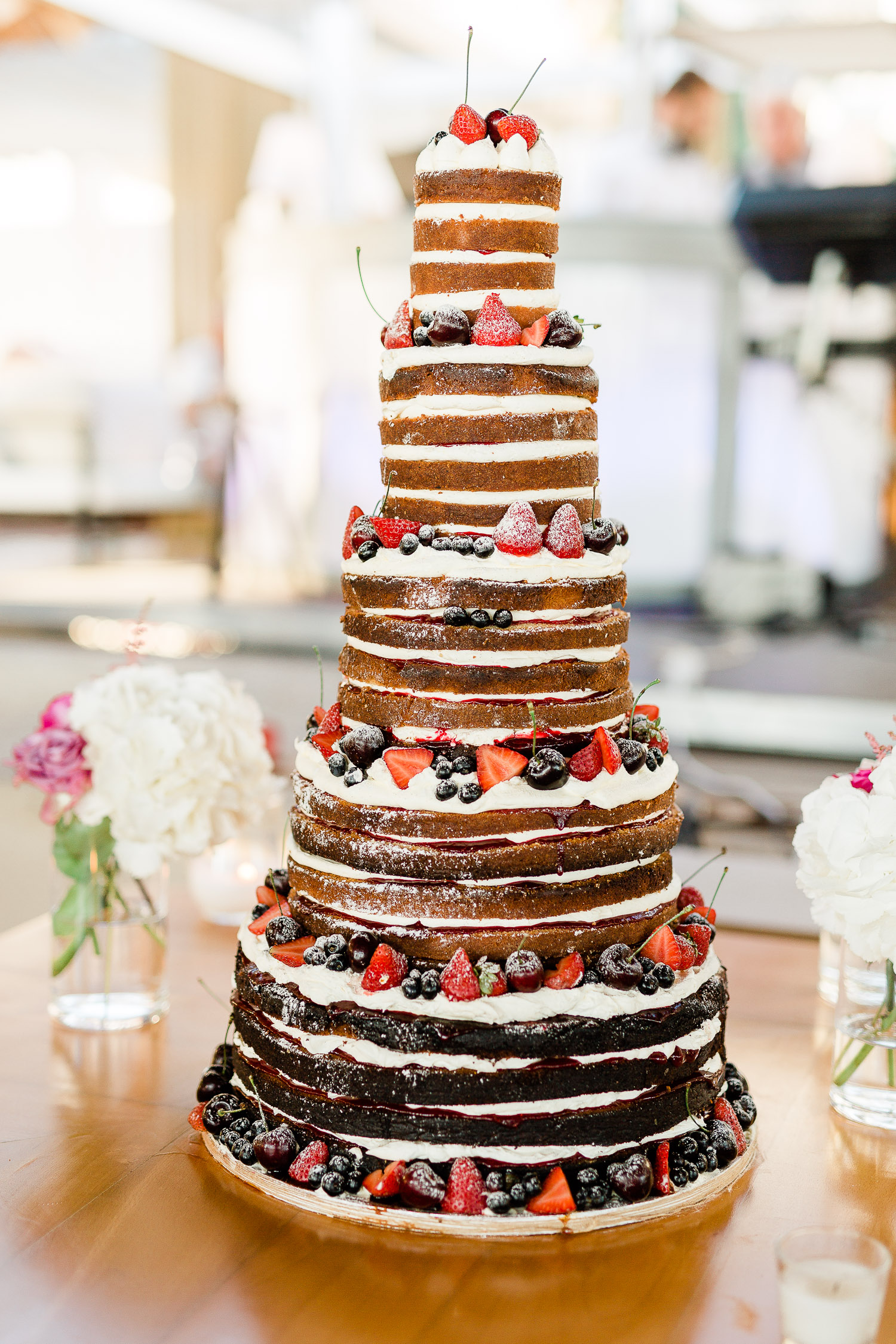 5-tiered, layered, brown-and-white ombré cake.