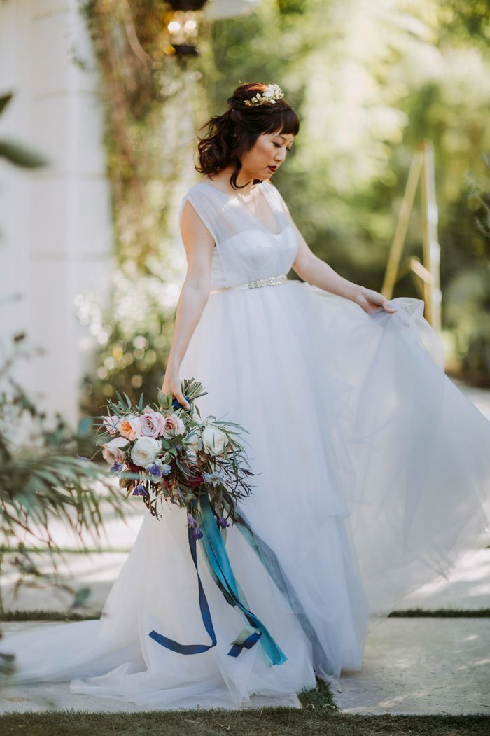 Bride wearing a ball gown dress with an embellished belt.