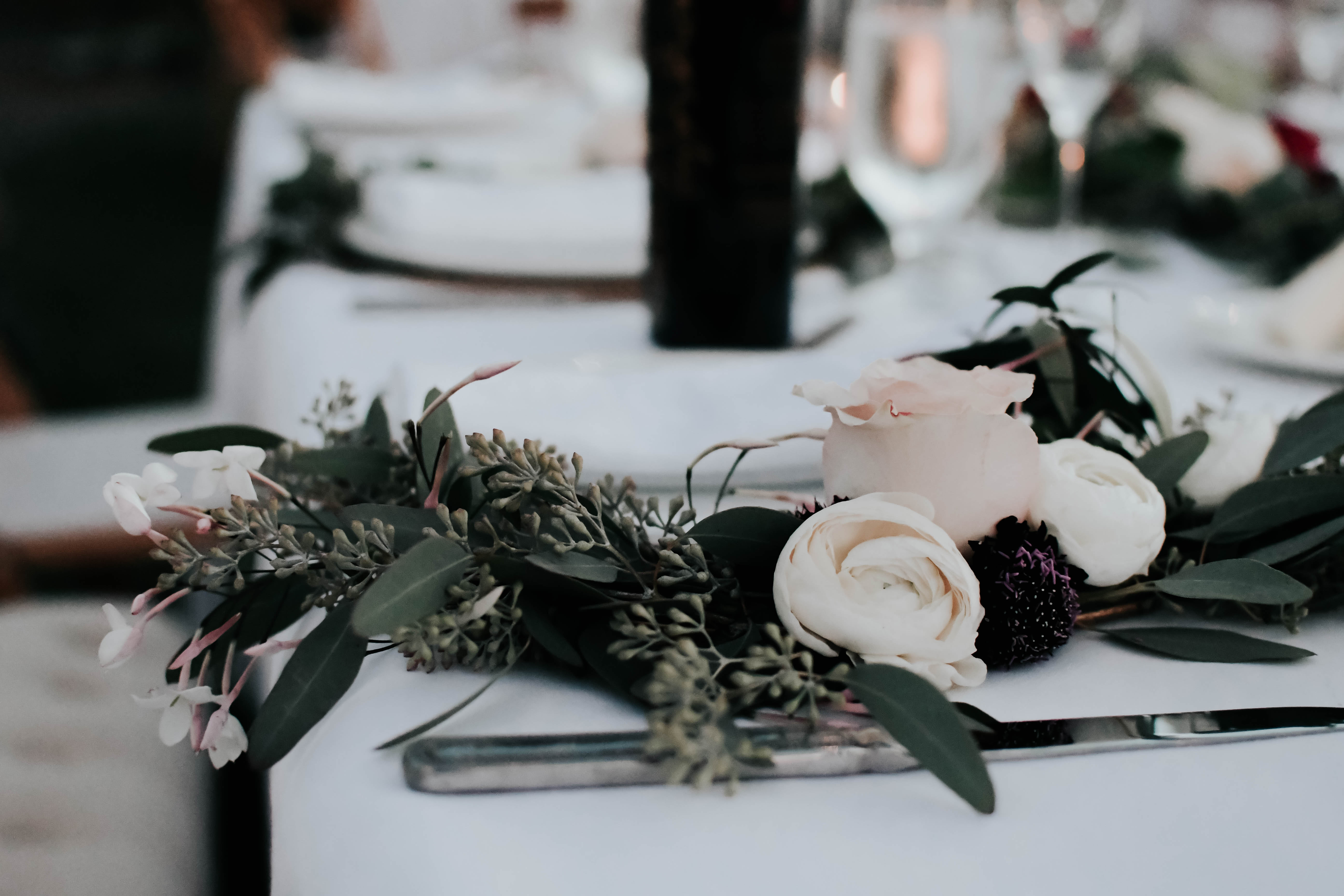Close-up of flowers on table decor.