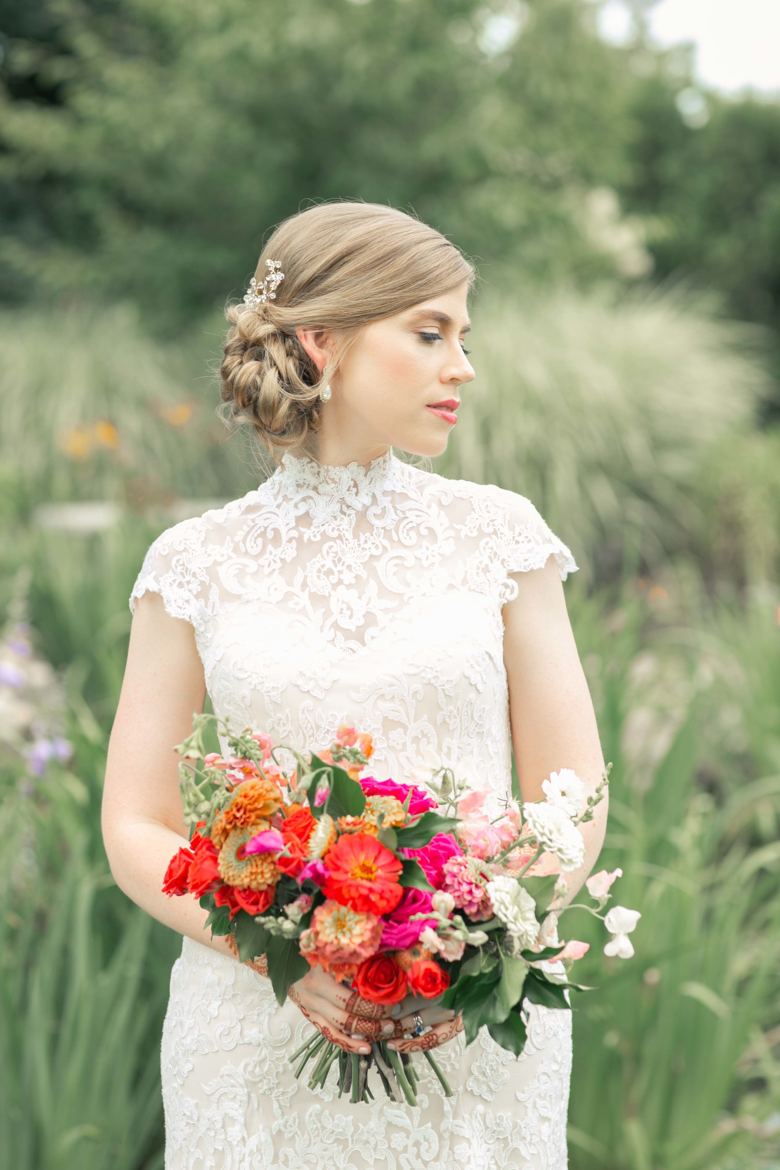 Anomalie bride wearing a short-sleeved, high collar gown.