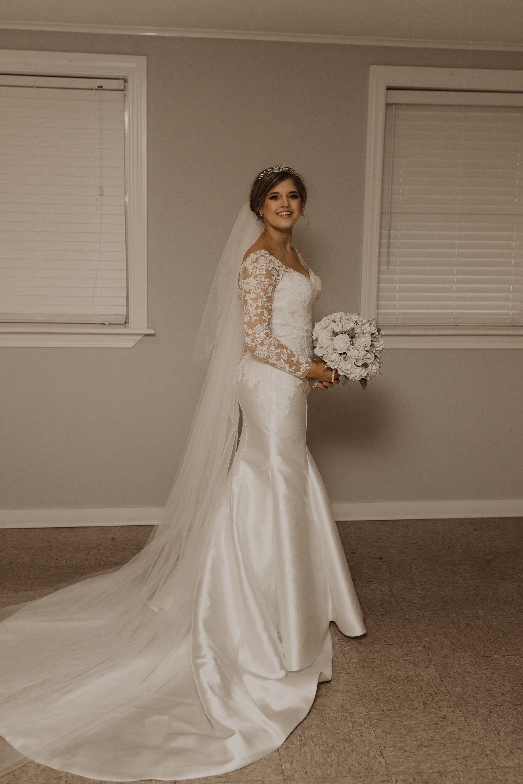 Custom Anomalie wedding dress with fit and flare shape, lace sleeves, sweetheart neckline, chapel train