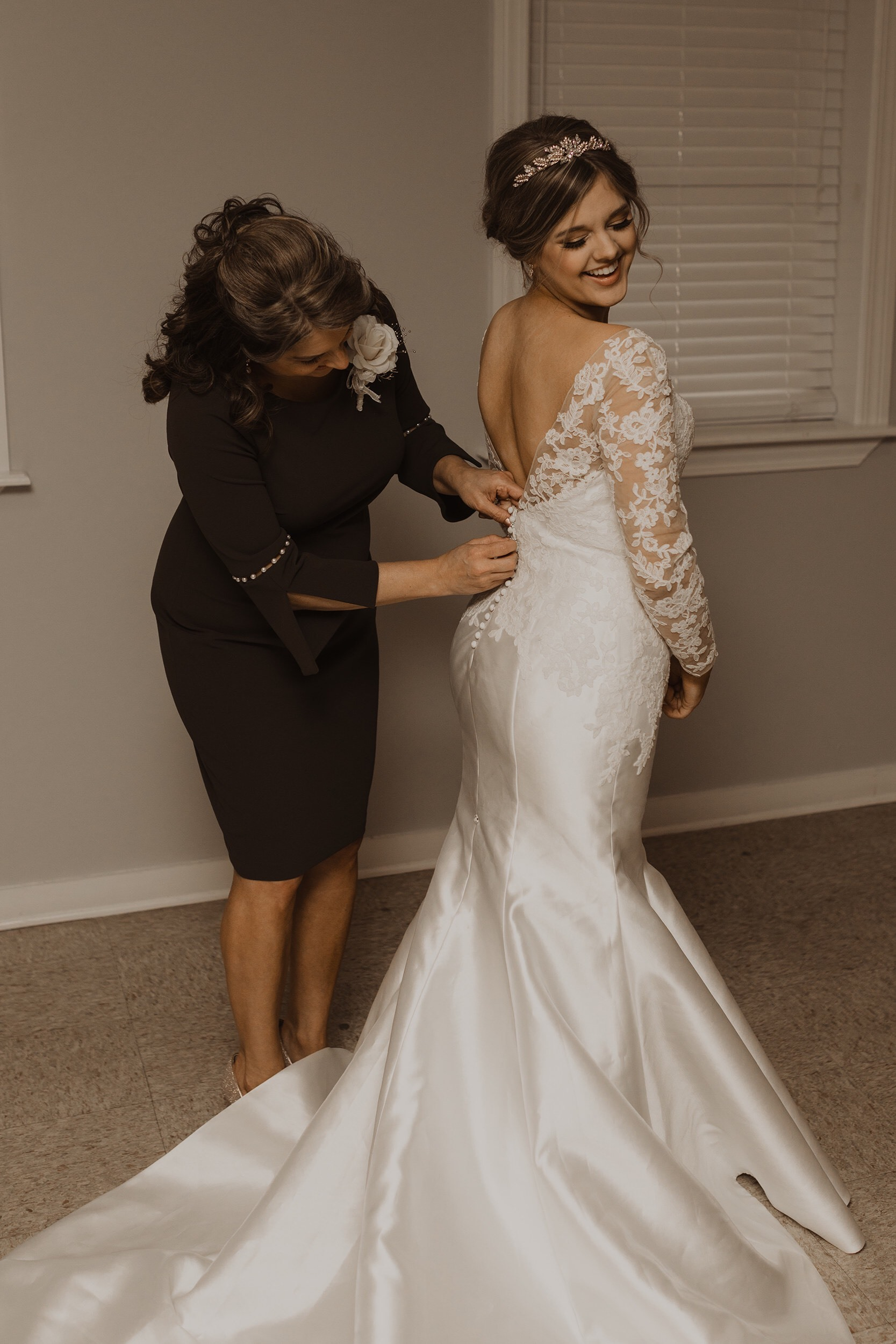 Anomalie bride Lauren getting ready in her fit and flare custom wedding dress