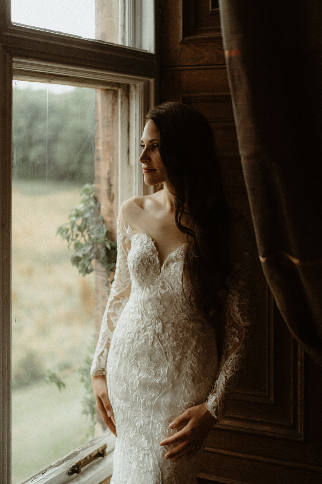 Anomalie bride wearing a dress with sheer long sleeves.