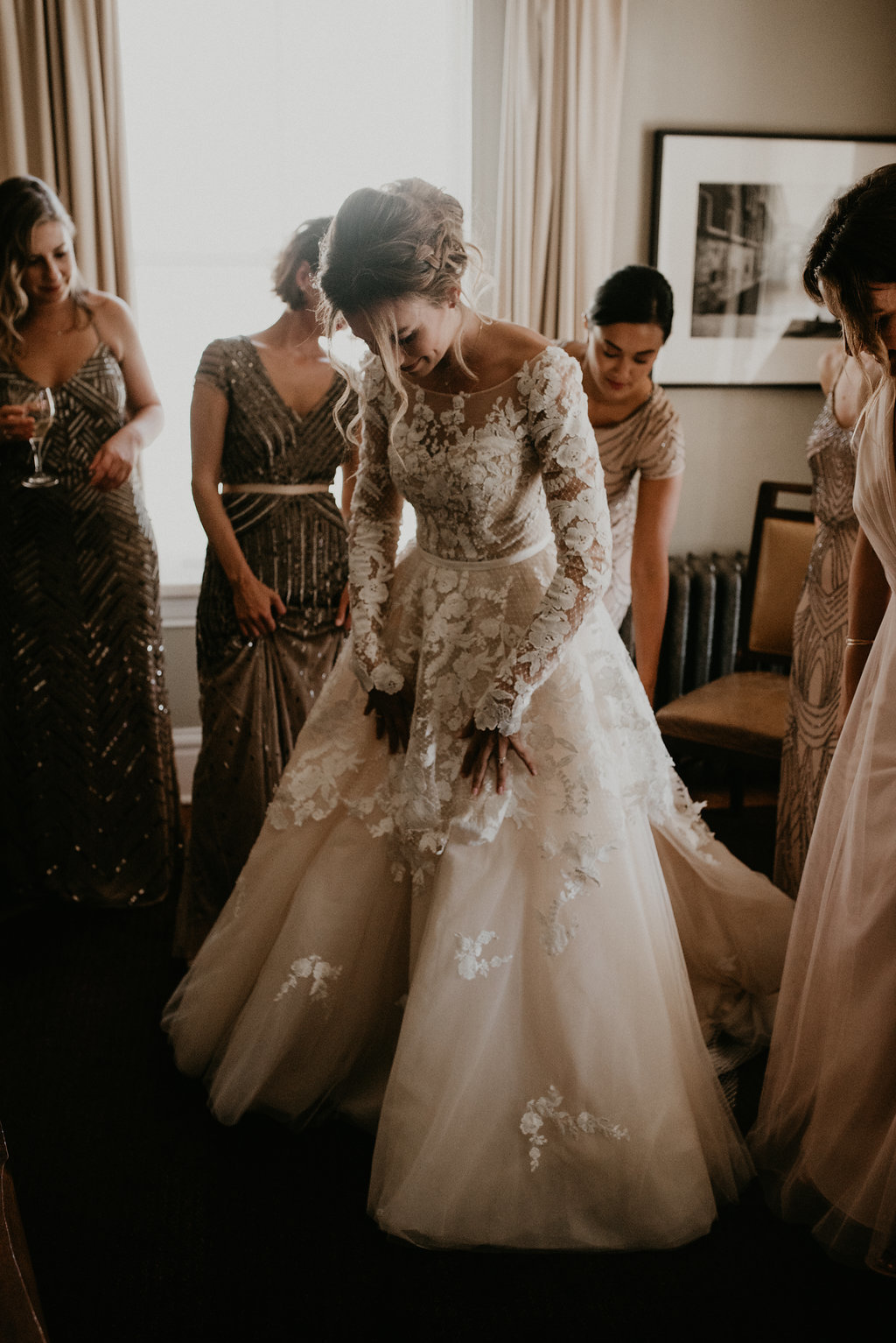 Custom lace wedding gown with blush overskirt