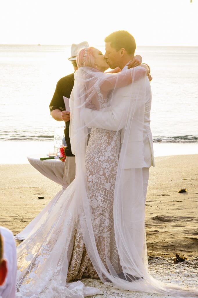 Bride and groom sunset ceremony in Costa Rica with custom bridal attire.