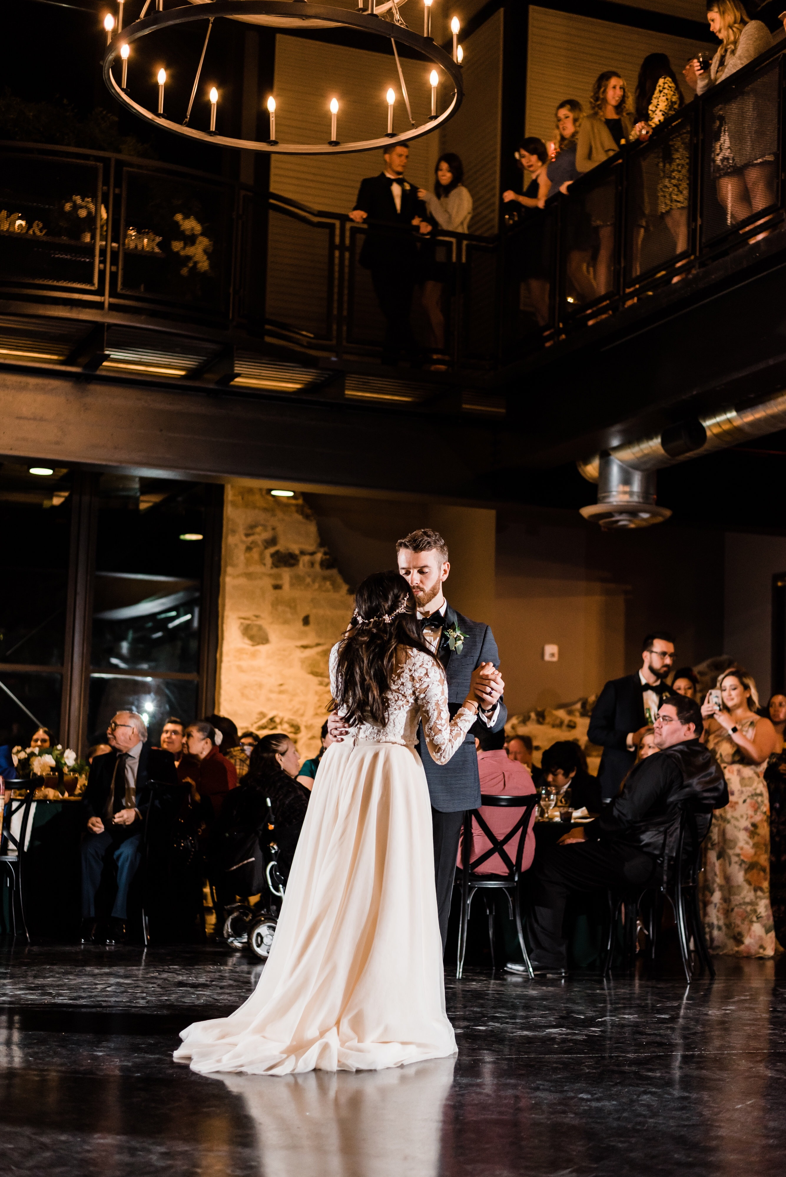 First dance. Bride is wearing a blush champagne circle dress with lace sleeves.